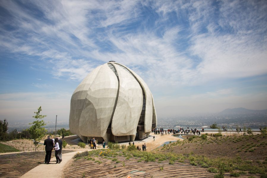 The temple's plan is based on a nine-part circle, with each segment forming a gently curving marble strip that spirals up to meet in a central oculus. Photo: Bahá'í World News Service/Raul Spinassé