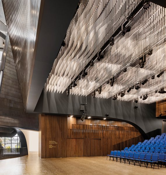 The performance hall includes flexible seating for 300 spectators and a moveable acoustic wall that allows the space to be closed for more intimate performances.