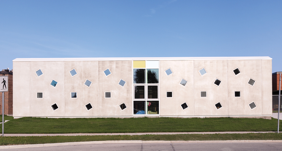 Insulated concrete panels were also used for BridgmanCollaborative's Mothering Project, an addition that bridges between an existing clinic and nursery.