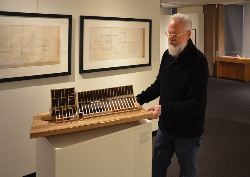 Architect David Bergmark places a model of the PEI Ark on its pedestal. Photo: John Leroux