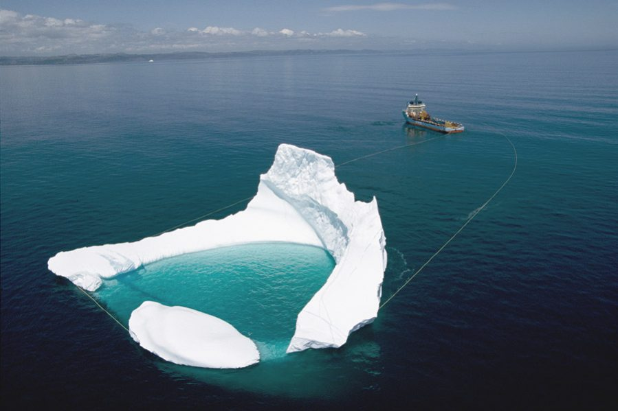 Towing an iceberg away from a collision course with the Hibernia oil platform in Grand Banks, Newfoundland in 2005. Photo: Randy Olson / National Geographic Creative