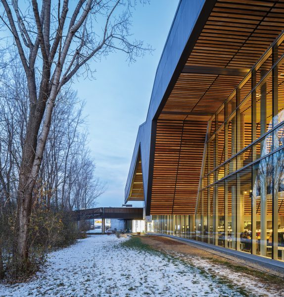The building's wood-clad eaves echo the surrounding landscape. Photo: Doublespace Photography