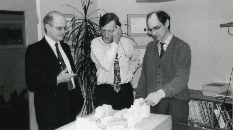 Partners Roger du Toit, Robert Allsopp, and John Hillier with a model of Toronto's Distillery District. Photo: DTAH