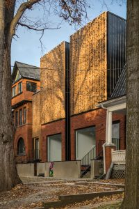 Double Duplex is a twinned pair of two-unit residences in Toronto's Parkdale neighbourhood that incorporates a finely patterned wood brise-soleil. Photo: Doublespace Photography